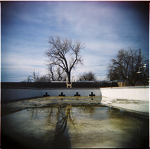 Empty pool in the spring with melted snow runoff